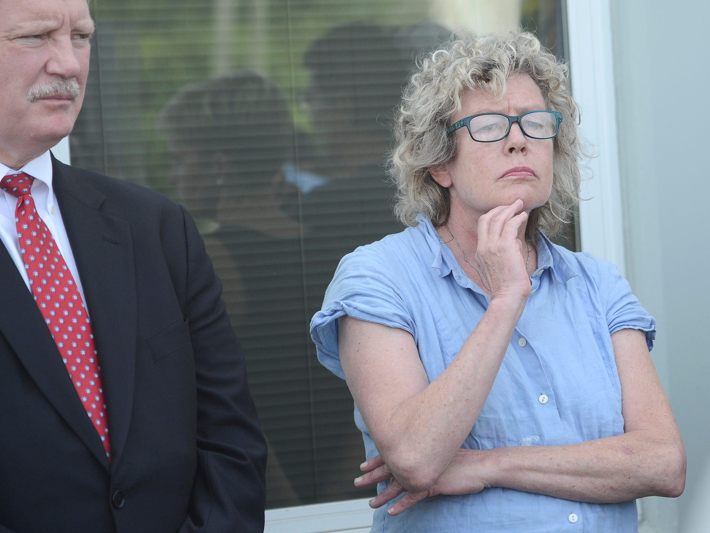 Mollie Tibbetts' mother, Laura Calderwood, listens
