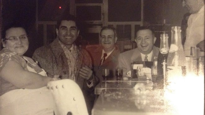 From left, this circa early 1950s photo shows Josephine Petrillo, singer Nicola Pavone and his bodyguards and Giuseppe Petrillo enjoying a late-night dinner after one of Nicola's shows at Giuseppe's, when it was located on State Street.