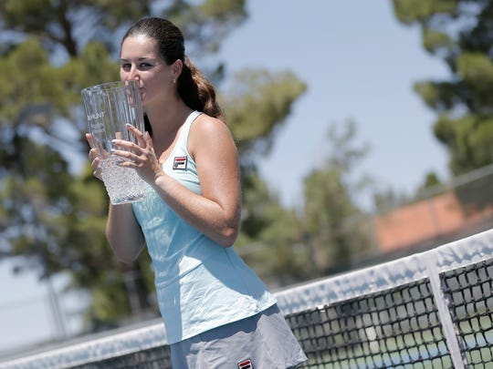 Jamie Loeb kisses the first place trophy after defeating Caitlin Whoriskey in the finals of the Hunt Communities $25,000 Women's Pro Tennis Classic at Tennis West in 2016. Loeb defended her title from 2015.