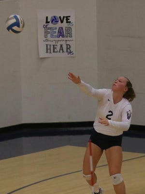 Emilee Augustine serves during TMP's match with Hill City on Tuesday at Al Billinger Fieldhouse.