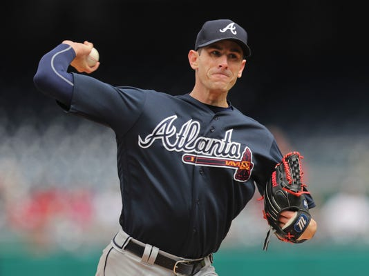 Atlanta Braves starting pitcher Brandon McCarthy throws a pitch against the Washington Nationals during the third inning of a baseball game at Nationals Park, Wednesday, April 11, 2018, in Washington. (AP Photo/Pablo Martinez Monsivais)