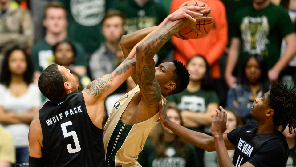 Kaileb Rodriguez battles for a rebound with Colorado