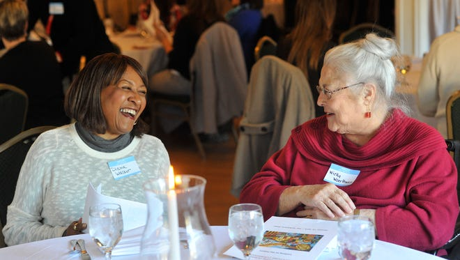 Longtime friends Diana Walker, left, and Wicky Woerthwein, share a laugh before the start of the diversity luncheon program hosted by the City of York Human Relations Commission at the Yorktown Hotel on Thursday.