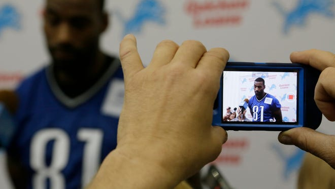 Detroit Lions wide receiver Calvin Johnson speaks to the media in Allen Park on May 28, 2014.