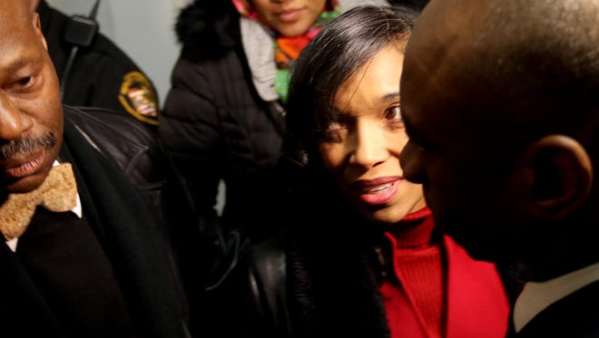 Suspended Hamilton County Juvenile Court Judge Tracie Hunter is surrounded by supporters Tuesday after it was announced that the remaining charges against her would be dismissed.