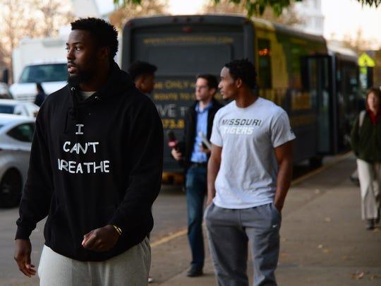 Missouri football player Charles Harris walks away