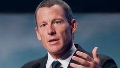 This file photo from 2012 shows Lance Armstrong speaking