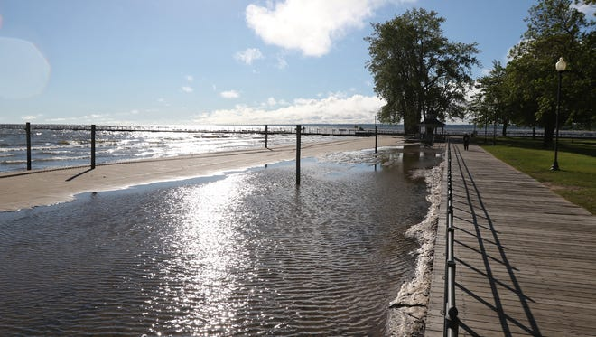 Water levels at Lake Ontario continue to rise cutting into the shoreline at Ontario Beach Park.  Wednesday morning all that was left of the beach was a small stretch of sand.
