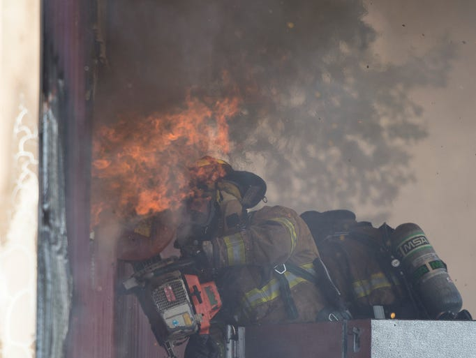 Fire crews battle a two-alarm fire in the 100 block
