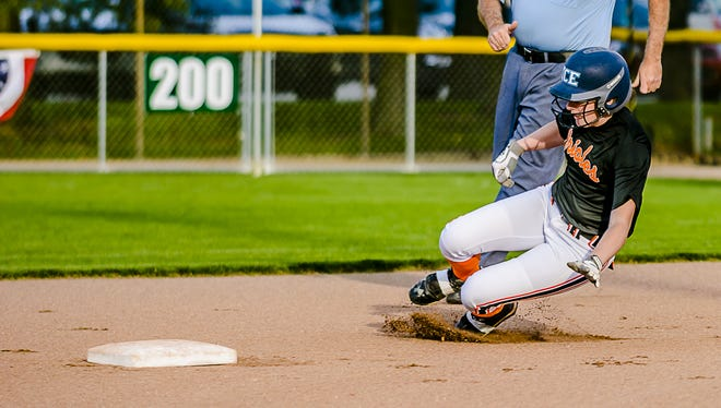 Averi Munro, shown sliding safely into second base during a game last month, is among the mid-Michigan seniors playing in Friday's Greater Lansing Sports Hall of Fame all-star softball game.