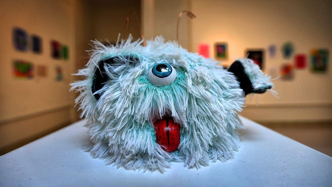 Memphis College of Art student Tawny Armus' furry monster is on display in MCA's gallery alongside the drawing that inspired it by Le Bonheur Children's Hospital patient Jordan Birch. The hospital is collaborating with the Memphis College of Art for a second year with MCA students, faculty and staff reimagining monsters originally created by the hospital's child patients.