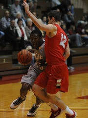 Vasha Davis of IU East makes a move at the basket during