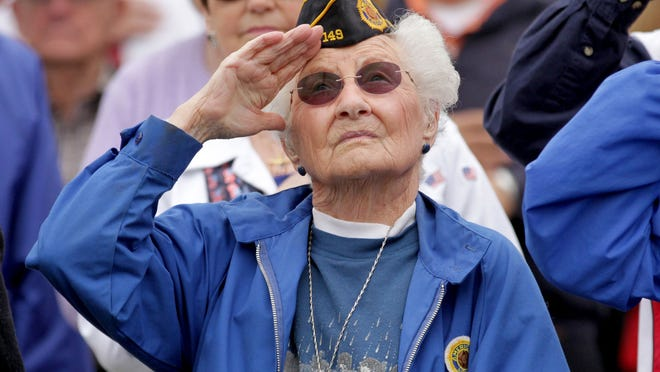 Ruth K. Turvey, of Salem, and a retired Marine, salutes the flag during the 35th annual Memorial Day service by the Greater Salem Area Veterans Organizations at City View Cemetery in Salem on Monday, May 25, 2015.