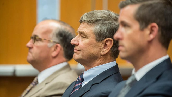 Erv Brinker, center, sits with attorneys Matthew Vicari, left, and Patrick O'Keefe during Brinker's arraignment in East Lansing on Wednesday.