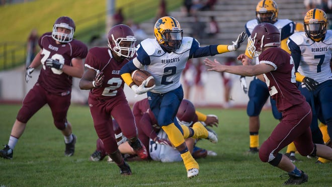 Battle Creek Central's Cyntell Williams (2) runs against Kalamazoo Central last season.