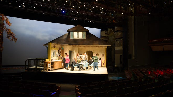 A group of theater patrons tour the set of Miracle on South Division Street, during Geva Theater's annual open house, held Monday night, January 18th.