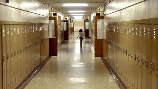 A Longfellow Elementary student walks the empty hallways during the last day of school in 2010.