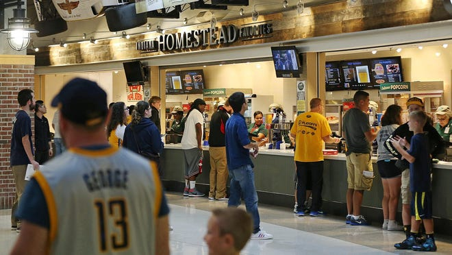 Fans stand in line for concessions before the Pacers faced the Chicago Bulls in an exhibition game at Banker's Life Fieldhouse in Indianapolis on  Thursday, Oct. 6, 2016.