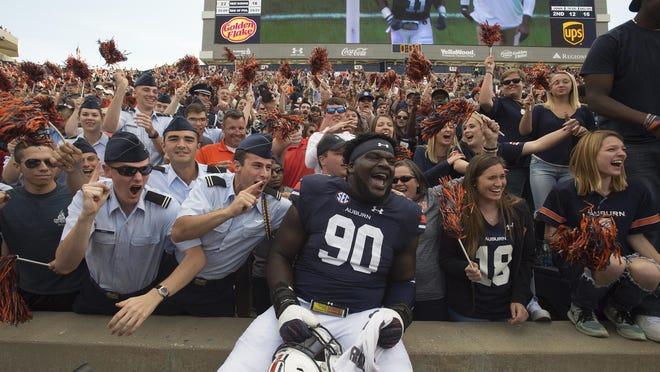 Auburn defensive lineman Maurice Swain Jr. celebrates with fans after the Tigers' win over Vanderbilt.