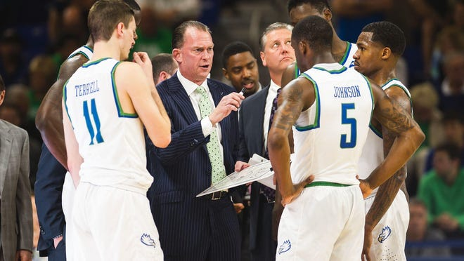 Florida Gulf Coast University's head coach Joe Dooley talks to his team during a game in January. He has had no comment on his level of interest in the New Mexico job.