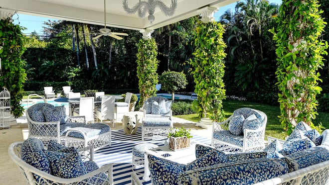 The poolside loggia at 200 Regents Park in Palm Beach is a centerpiece of the backyard, which was re-landscaped as part of a major renovation project.