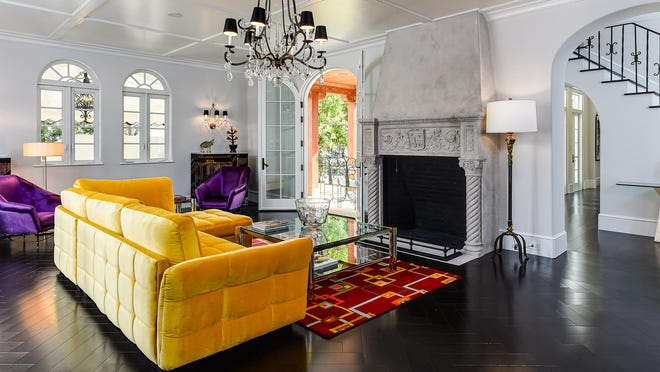 The living room's original fireplace was restored during a major renovation project at this 1920s-era landmarked house in Palm Beach at 212 Seaspray Ave., which has been listed for sale at $7.5 million.
