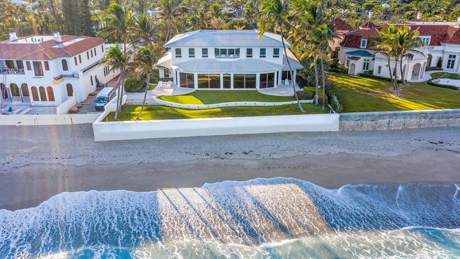 With a wall of glass on the ground floor facing the sea, a 1960s-era house at 1063 N. Ocean Blvd. has sold for $25.37 million, according to an update in theh Palm Beach Board of Relators Multiple Listing Service. The house was the longtime home of a late couple known for their philanthropy -- industrialist Morton L. Mandel and his wife, Barbara.