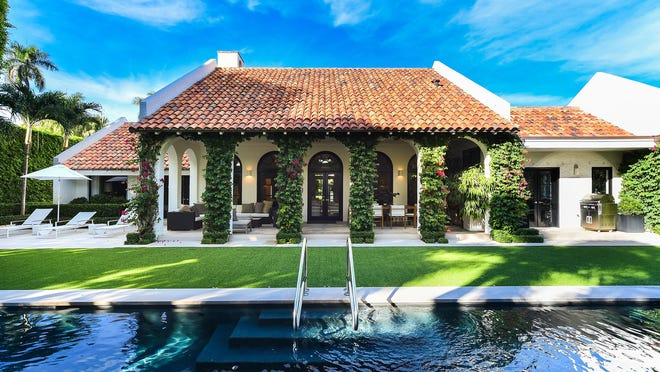 A loggia with a series of arches faces the swimming pool at 402 Primavera Ave., a Palm Beach house on a half-acre lot that just sold for a recorded $7.13 million.