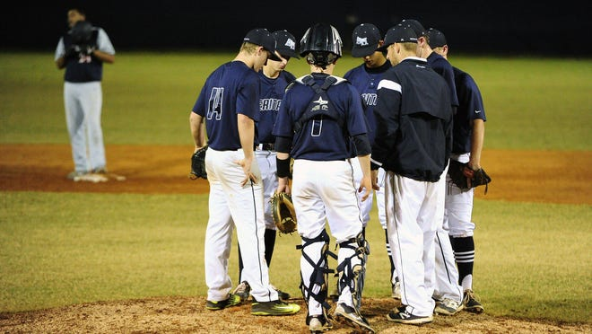 In this 2016 photo, American Heritage has a meeting on the mound during a game against Oxbridge Academy at American Heritage in Delray Beach.