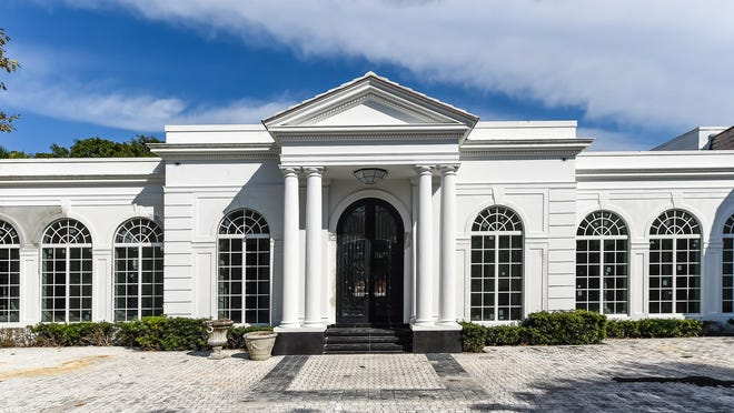 Built in 1996 and partially remodeled, this Palm Beach Regency-style house at 1230 S. Ocean Blvd. has seven bedrooms and 10,383 square feet of living space, inside and out. A company managed by businessman Thomas Maoli just sold it for a recorded $11.5 million.