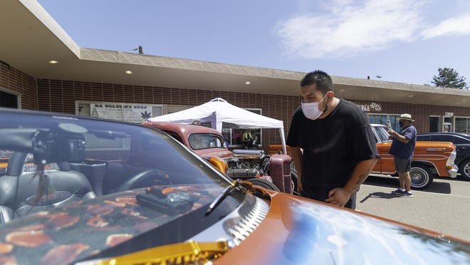 Christopher Osorio looks at a detailed paint job on Tuesday during the kickoff for the People Helping People in the Pueblo Community event.