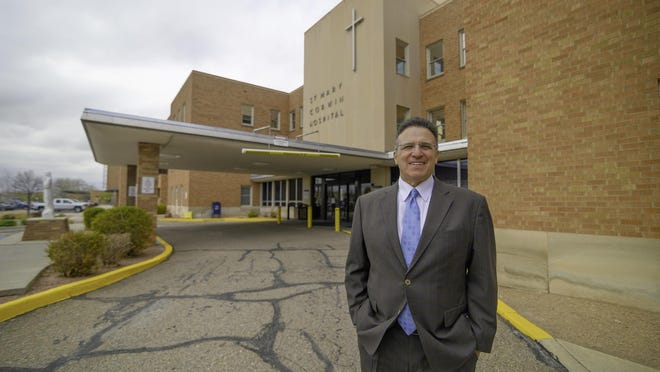 Mike Cafasso, chief executive officer for St. Mary-Corwin, stands outside of the East Tower.