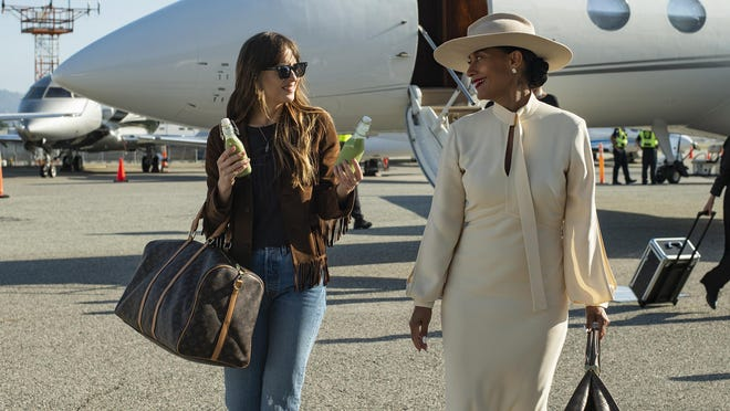 "Dakota Johnson stars as assistant Maggie Sherwoode for Tracee Ellis Ross's diva Grace Davis in ""The High Note."""