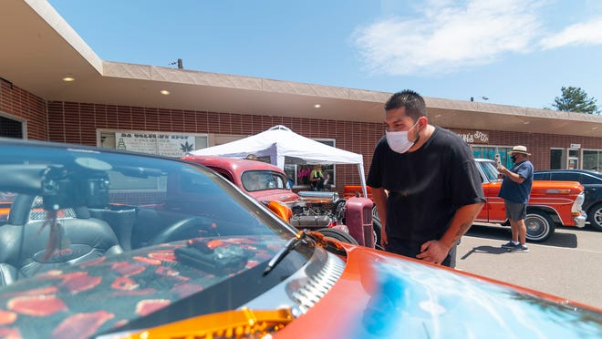 Christopher Osorio looks at a detailed paint job during the kickoff for the People Helping People in the Pueblo Community event on Tuesday.