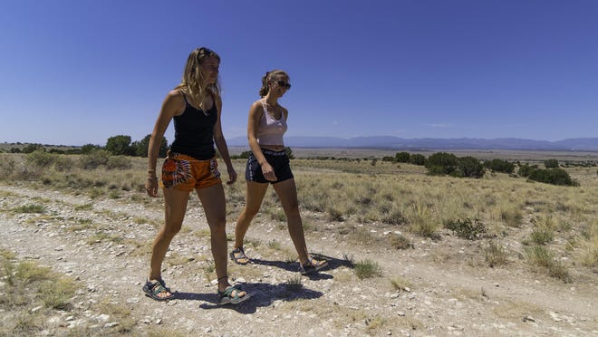Katy Grieb, left, and Taylor Furrh walk along the trails at the south side of Lake Pueblo.