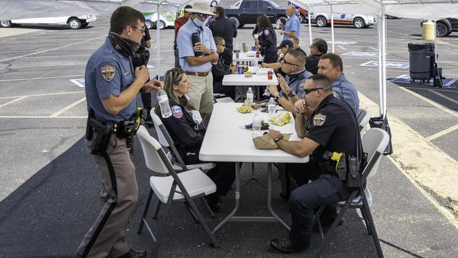 First responders from across Pueblo County eat a free lunch as part of an event hosted by Fellowship of the Rockies to thank first responders on Thursday.
