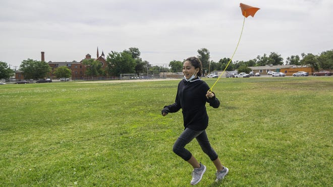 Alessandra Ramirez, 10, sees a kite she created take flight at the Boys and Girls Clubs' Sprague location Tuesday.