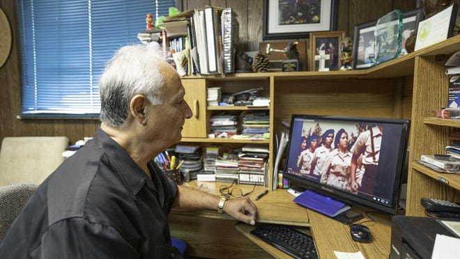 Steve Lucero watches videos of the Chicano Moratorium, which culminated in the 1970 march in East Los Angeles.