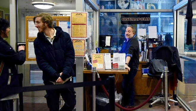 Brett Bossard, right, executive director of Cinemapolis, at the theater's box office in downtown Ithaca. The five-screen movie theater, a not-for-profit since 2000, specializes in independent, foreign and locally produced films.