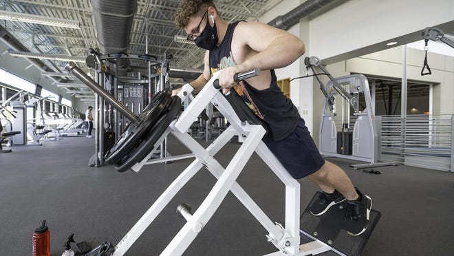 Chris Moody works out at the ThunderWolf Recreation Center on Tuesday after it reopened to faculty, staff and students.