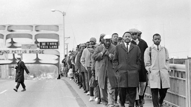 "John Lewis, at right, with fellow protestors at Edmund Pettus Bridge, in ""John Lewis: Good Trouble."""