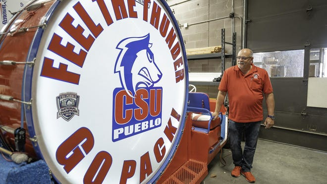 Anthony Bonfiglio looks over one of his favorite things at Colorado State University Pueblo. The mobile drum is used to is celebrate touchdowns at the Neta & Eddie DeRose ThunderBowl on game days.