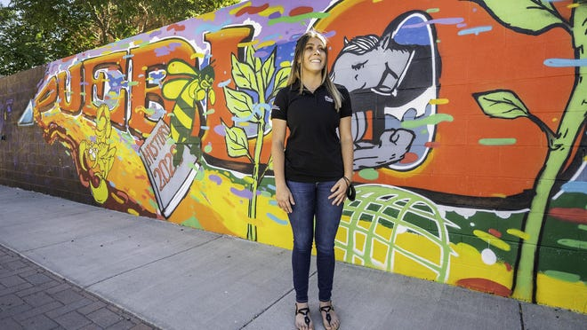 Jacelynn Trujillo stands in front a mural that celebrates Pueblo's young people and the community itself for resilience during the COVID-19 pandemic. Trujillo proposed the idea for the mural to local health department leaders back in the spring.