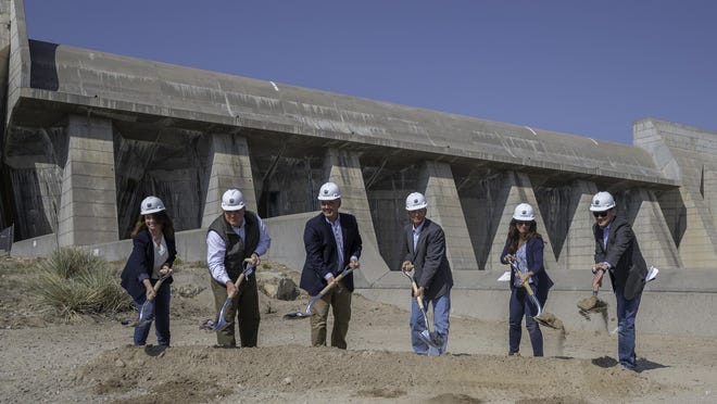 National and local leaders break gound during a ceremony for the Arkansas Valley Conduit.