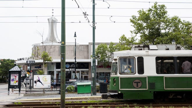 A Green Line train travels inbound from the Coolidge Corner stop in Brookline.
