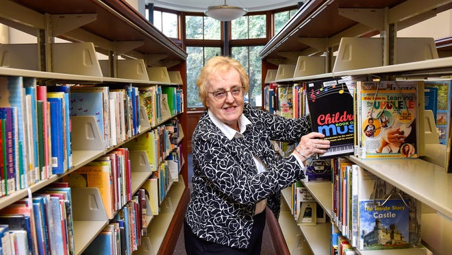 Dorothea Lam, new head librarian of the Beverly Farms branch of Beverly Public Library, poses for a photo inside the library on Thursday, Oct. 1. Wicked Local Staff Photo / David Sokol]