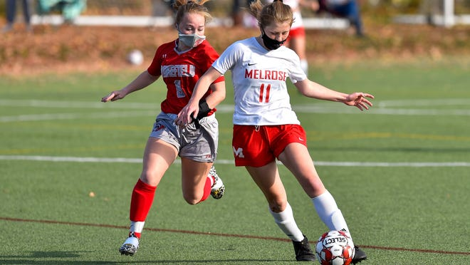Hailey Keegan of Melrose dribbles the ball, while being trailed by a Wakefield player during a game at the Wakefield Middle School on Saturday, Oct. 24.