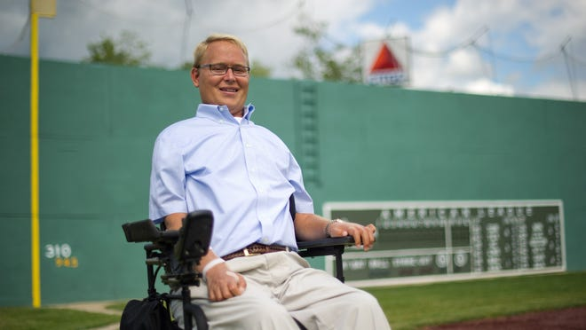 "Travis Roy, shown before a charity Wiffle Ball tournament to benefit the Travis Roy Foundation at ""Little Fenway"" in Essex, Vt., on August 12, 2011, died from complications from surgery on Thursday. The former Boston University hockey player, who was paralyzed in his first ever shift, was 45 years old."