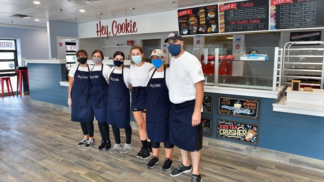 The Cookie Monstah employees, left to right, Kula Irving, Deya Arnold, Bella Irving, Lily Brown and Shannon Cyr pose for a photo with Jay Walsh, general manager, inside their newest location in Swampscott on Paradise Road on Tuesday, Aug. 18, 2020.