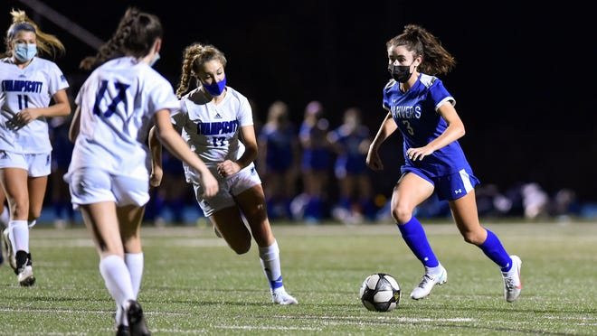Arianna Bezanson of Danvers dribbles the ball past midfield during a game against Swampscott at Danvers High School last November. There was no postseason last year, because of the pandemic, but Bezanson still won the Massachusetts Gatorade Player of the Year Award, while also being named All-American. She's now a senior captain, and hopes to help lead her teammates to the state tournament as it is back after a two-year hiatus.